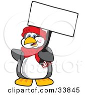 Clipart Illustration Of A Penguin Mascot Cartoon Character Holding A Blank White Sign by Toons4Biz