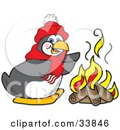 Chilly Penguin Mascot Cartoon Character Warming His Hands Over A Fire
