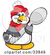 Clipart Illustration Of A Penguin Mascot Cartoon Character Holding A Big Spoon by Toons4Biz