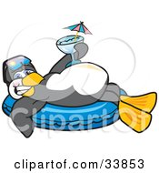 Happy Penguin Mascot Cartoon Character Relaxing On An Inner Tube Holding A Cocktail While On Vacation