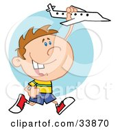 Clipart Illustration Of A Little Boy Having Fun Smiling And Running With A Toy Airplane