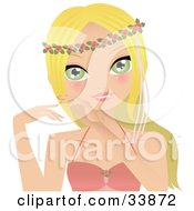 Beautiful Green Eyed Blond Caucasian Woman Wearing A Floral Head Band And A Pink Top