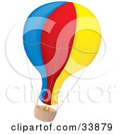 Blue Red And Yellow Air Balloon With A Basket Flying Through The Air