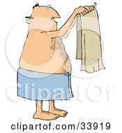 Man With A Hairy Chest And Balding Head Wrapped In A Blue Towel Holding Up A Clean Beige Towel