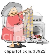Clipart Illustration Of A Gray Haired Woman Holding Up A Clean Towel In Front Of A Washer And Dryer While Doing Laundry