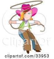 Teenage Cowgirl In Chaps And A Pink Hat Swinging A Lasso