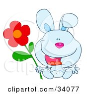 Clipart Illustration Of A Happy Blue Bunny Rabbit Sitting With A Red Daisy Flower