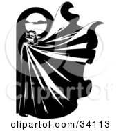 Clipart Illustration Of A Mysterious Male Vampire Standing Below A Full Moon With His Cape Flapping In The Wind