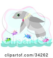 Clipart Illustration Of A Happy Seal Swimming With Colorful Fish by bpearth