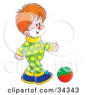 Clipart Illustration Of An Adorable Red Haired Clown In A Green And Yellow Polka Dot Costume Kicking A Ball
