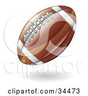 Clipart Illustration Of A Hovering American Football by AtStockIllustration