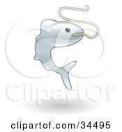 Clipart Illustration Of A Gray Fish Hooked On A Fishermans Line by AtStockIllustration