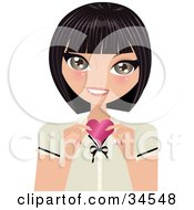 Clipart Illustration Of A Sweet Caucasian Woman Holding Up A Pink Heart