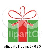 Clipart Illustration Of A Red Bow On Top Of A Green And Red Christmas Gift