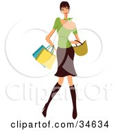 Stylish Caucasian Woman With Black Hair Dressed In Boots A Skirt And Green Top Carrying Shopping Bags And A Purse