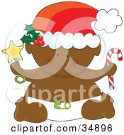Clipart Illustration Of A Black Christmas Baby In A Diaper Holding A Star Rattle And Candycane Wearing A Santa Hat by Maria Bell