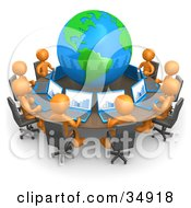 Clipart Illustration Of A Group Of Orange People Working On Laptops At A Round Table With A Globe In The Center