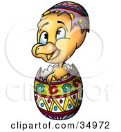 Clipart Illustration Of A Cute Yellow Chick Hatching From A Colorful Easter Egg
