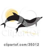 Clipart Illustration Of Two Black Silhouetted Dolphins Jumping Over The Water At Sunset