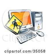 Yellow Digging Construction Sign Over A Desktop Computer