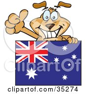 Clipart Illustration Of A Friendly Brown Dog Grinning And Waving While Standing Behind An Australian Flag