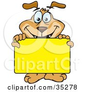 Smiling Brown Dog Holding Up A Blank Yellow Sign Board Ready For You To Insert Text