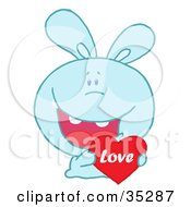 Clipart Illustration Of A Caring Blue Rabbit Laughing And Holding A Red Heart Love Valentine