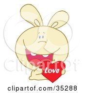 Clipart Illustration Of A Caring Yellow Rabbit Laughing And Holding A Red Heart Love Valentine