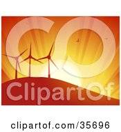 Clipart Illustration Of Silhouetted Birds Flying In An Orange Sunset Sky Above Three Turbines On A Hill Of A Wind Farm by elaineitalia