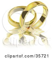 Two Golden Wedding Band Rings On A Rippling Reflective White Surface