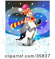 Cold Penguin In A Scarf And A Hat Shoveling Snow On A Snowing Day