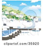 Coastal Village Of Homes On A Hillside Over A Harbor