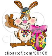 Clipart Illustration Of A Bunny Rabbit Signaling The Peace Sign And Standing With An Easter Egg by Dennis Holmes Designs