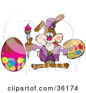 Clipart Illustration Of A Bunny Rabbit Artist Painting An Easter Egg With A Brush