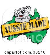 Clipart Illustration Of A Koala Giving The Thumbs Up On An Aussie Made Sign Over A Map by Dennis Holmes Designs