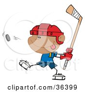 Clipart Illustration Of A Boy Sticking His Tongue Out And Hitting A Hockey Puc by Hit Toon