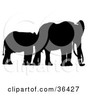 Clipart Illustration Of A Juvenile Black Silhouetted Elephant With Its Mother