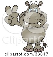 Clipart Illustration Of A Peaceful Hippo Smiling And Gesturing The Peace Sign With His Hand