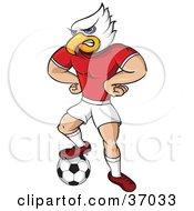 Eagle Mascot In Uniform Standing With His Hands On His Hips And One Foot On A Soccer Ball