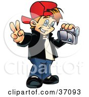 Clipart Illustration Of A Happy Young Boy Gesturing The Peace Sign And Using A Handy Cam