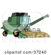 Male Farmer Operating A Green Harvester On His Farm