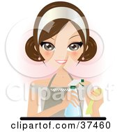 Pretty Brunette Maid In An Apron Spraying Cleaner Onto A Rag