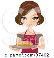 Pretty Female Sandwich Artist Carrying A Fresh Sub On A Platter