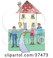 Male Realtor Handing A Large Skeleton Key To A Couple On The Lawn Of Their New Home