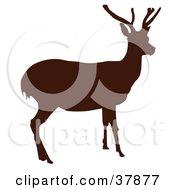 Clipart Illustration Of A Dark Brown Deer Silhouette