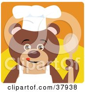 Brown Teddy Bear In An Apron And Chefs Hat Holding A Spoon
