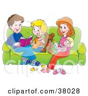 Happy Family Of Four Reading On A Couch