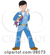 Friendly Caucasian Man In A Blue Uniform Holding A Caulking Gun