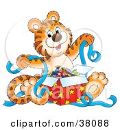 Clipart Illustration Of A Happy Tiger Holding Ribbons While Opening Presents by Alex Bannykh