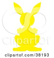 Clipart Illustration Of A Yellow Silhouetted Rabbit